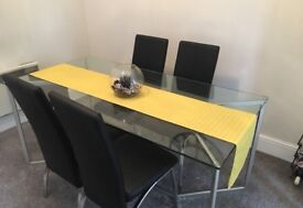 Glass dining table and 4 Faux Leather Chairs