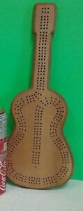HAND CARVED GUITAR SHAPED CRIB BOARD