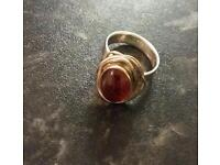 Silver ring with amber stone