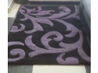 Black and purple rug
