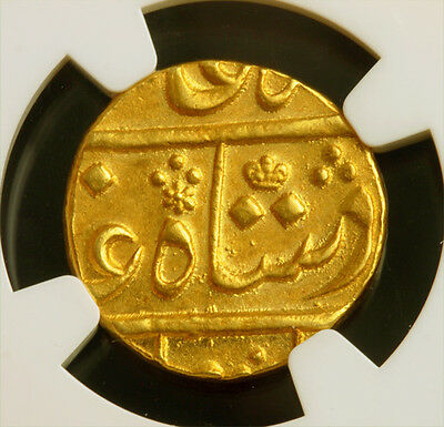 Click now to see the BUY IT NOW Price! 1831 BRITISH INDIA BOMBAY PRESIDENCY. HAMMERED GOLD MOHUR COIN. NGC MS 62