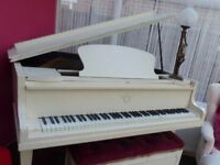 Baby Grande Piano In Cream. Tuned regularly and plays beautifully. Few scratches.