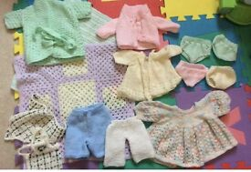 Knitted newborn dolls clothes