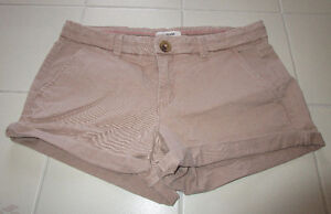Girls tan button up shorts from Garage size 3