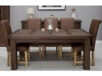 Sold Oak dining room table and chairs