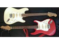 2x stratocastor style electric guitars