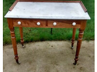 Victorian two drawer Marble top washstand on casters