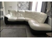 3 months old DFS black and white curved leather corner sofa in excellent condition