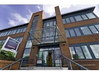 A tall brick and glass building which has a variety of corporate style offices available.