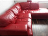 RED LEATHER CORNER SOFA AND FOOTSTOOL USED VERY COMFY CAN DELIVER