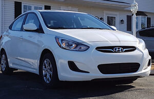 2014 Hyundai Accent GLS (27,000 kms) + winter tires on rims