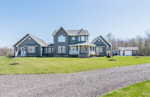**UNIQUE HOME WITH IN-LAW SUITE ON PRIVATE 2.3 ACRE LOT**