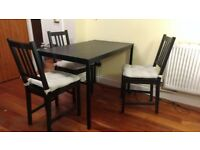 Black wooden table and 3 chairs