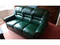 Green leather 3 person sofa with matching easy chair