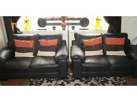2x2 seater faux leather sofas . Not even a year old.