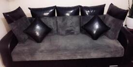 Dark grey/black sofa bed with storage
