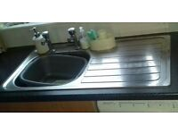 Standard used kitchen sink and taps