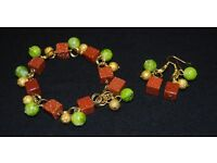 Bracelet and earrings made from desert sand cubes, painted glass on gold-plated base