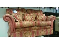 Patterned red/gold 2 seat sofa