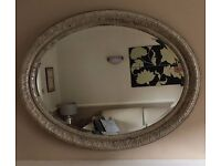 STUNNING OVAL MIRROR WITH EMBOSSED FRAME