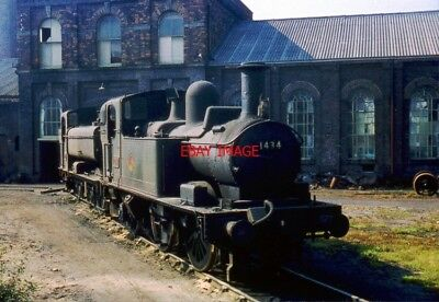 PHOTO  EX. GWR 0-4-2T 1434 SITS IN THE SUN AT ST. BLAZEY SHED IN CORNWALL.  12TH