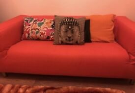Orange ikea sofa
