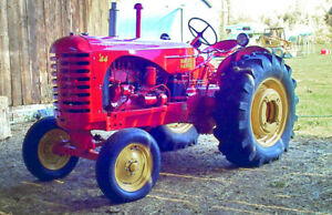1950 Massey Harris 44 Tractor with wheel weights and fly wheel