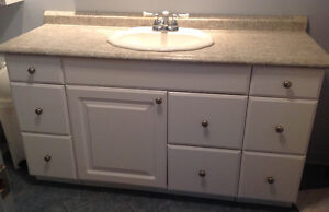 Vanity, sink, faucet and counter complete.