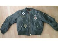 Brand new with tags green bomber jacket badges size 20 latge