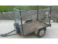 Small trailer with cage mesh sides