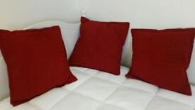 3 red cushions