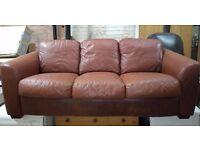 Brown leather sofa settee