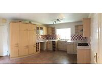 Kitchen fully fitted with integrated fridge and freezer, work tops, & cooker with oven and grill