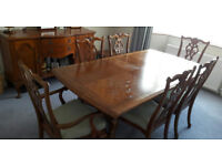 Extending dark wood table and six chairs