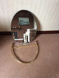 Oval Mirror With Fluted Edges In A Gold Surround