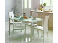 Lido white glass dining table and 4 chairs