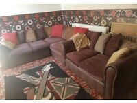 Nice brown corner sofa + 2 seater sofa + footstool - can deliver too