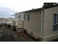Stunning large 2 bedroom holiday home overlooking Gareloch with a side deck.