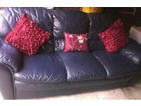 Lovely and comfy 3 seater 2 seater and pouffe blue leather very comfy