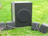 LG subwoofer and 4 surround sound speakers