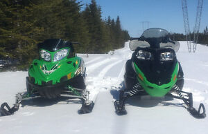 PAIR ARCTIC CAT SNOWMOBILES AND DOUBLE TRAILER