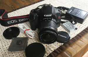 Canon 550D / T2i 18MP DSLR with 18-55mm IS,  also takes HD Video