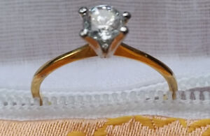 Ring, beautiful engagement simulated diamond.  Now only $25