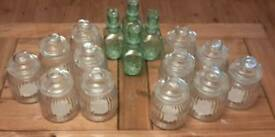 16 Glass Containers and 9 Woodern Scoops (to fit in clear jars)