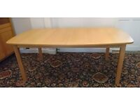 Ikea extendable dining table. Excellent condition. Seats upto 8/10 when fully extended