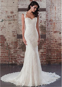 Beautiful beaded lace wedding dress (never worn)