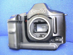 Various Canon SLR film cameras, lenses, flashes and accessories