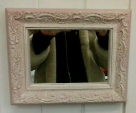 Pink ornate mirror