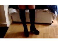 Over the knee black boot heels