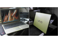 """Lime green Dual-Core Sony Vaio 13.3"""" laptop."""